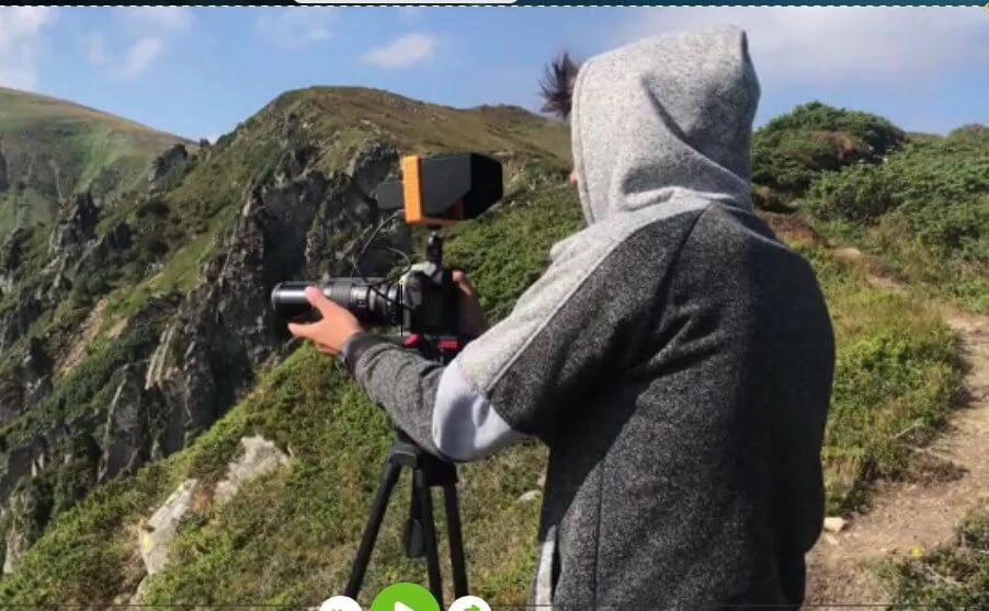 A cameraman shooting outside
